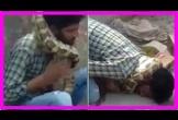 Bị siết cổ suýt chết khi đang biểu diễn với trăn trên phố